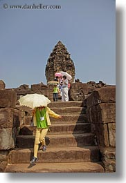 asia, bakong, cambodia, japanese, tourists, umbrellas, vertical, photograph