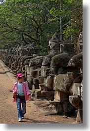 asia, cambodia, gates, girls, pink, south gate, statues, vertical, walking, photograph