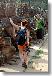 asia, cambodia, gates, men, photographing, south gate, vertical, womens, photograph
