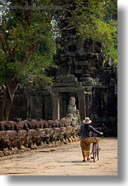 asia, bicycles, cambodia, gates, pushing, vertical, victory gate, womens, photograph