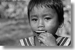 asia, black and white, boys, cambodia, eating, horizontal, leaves, people, photograph