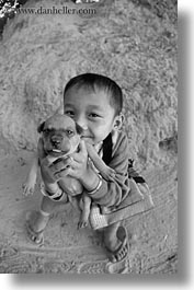 asia, black and white, boys, cambodia, people, puppies, vertical, photograph