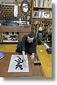 asia, calligraphers, finishing, japan, people, spray, vertical, photograph
