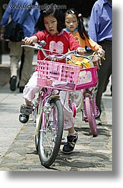 asia, bicycles, girls, japan, people, red, vertical, photograph