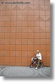 asia, bicycles, cellphone, japan, men, people, vertical, photograph