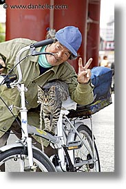 asia, bicycles, cats, japan, men, people, vertical, photograph
