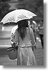 asia, black and white, girls, japan, people, umbrellas, vertical, womens, photograph