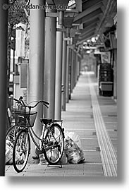 asia, bicycles, black and white, japan, parked, takayama, towns, vertical, photograph