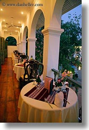archways, asia, buildings, dining, hotels, laos, luang prabang, structures, tables, vertical, photograph