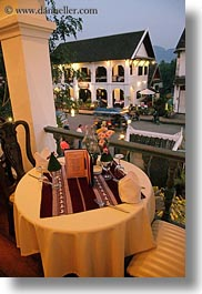 asia, buildings, dining, hotels, laos, luang prabang, structures, tables, vertical, photograph