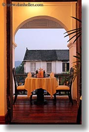 archways, asia, buildings, dining, doorways, hotels, laos, luang prabang, structures, tables, vertical, photograph