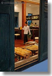 asia, buffet, buildings, foods, hotels, laos, luang prabang, men, open, people, server, structures, vertical, windows, photograph
