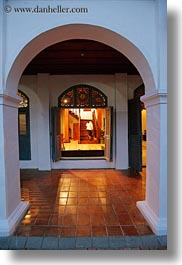 archways, asia, buildings, glow, hotels, laos, lights, luang prabang, open, structures, vertical, windows, photograph