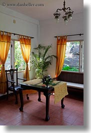 asia, buildings, chairs, hotels, laos, luang prabang, nature, palm trees, plants, structures, tables, trees, vertical, windows, photograph