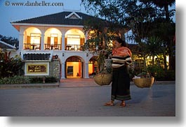 archways, asia, buildings, carrying, don ganh, dusk, glow, horizontal, hotels, laos, lights, luang prabang, structures, womens, photograph