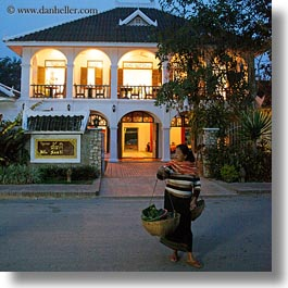 asia, buildings, carrying, don ganh, dusk, glow, hotels, laos, lights, luang prabang, square format, structures, womens, photograph