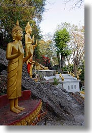 asia, buddhas, buildings, golden, laos, luang prabang, phou si mountain, statues, temples, vertical, photograph