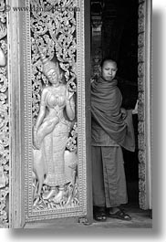 apsara, asia, black and white, buddhist, buildings, doors, golden, laos, luang prabang, monks, people, religious, temples, vertical, womens, xiethong, photograph