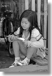 asia, asian, black and white, childrens, eating, girls, laos, luang prabang, people, vertical, yellow, photograph