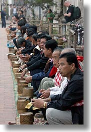 asia, asian, baskets, laos, luang prabang, men, offerings, people, rice, vertical, photograph