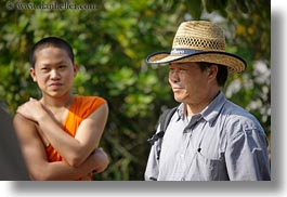 asia, clothes, emotions, hats, horizontal, laos, luang prabang, men, monks, people, smiles, straw hat, tour guides, photograph