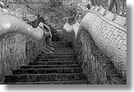asia, asian, black and white, boy and stairs, boys, colors, horizontal, laos, luang prabang, men, monks, oranges, people, snakes, stairs, photograph