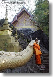 asia, asian, boy and stairs, boys, colors, laos, luang prabang, men, monks, oranges, people, snakes, stairs, vertical, photograph