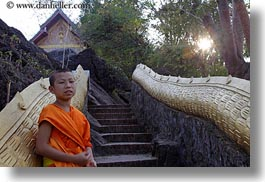 asia, asian, boy and stairs, boys, colors, horizontal, laos, luang prabang, men, monks, oranges, people, snakes, stairs, photograph
