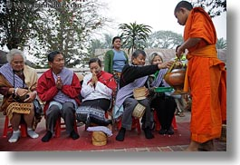alms, asia, asian, colors, giving, giving alms, horizontal, laos, luang prabang, men, monks, oranges, people, procession, photograph