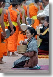 alms, asia, asian, colors, giving, giving alms, laos, luang prabang, men, monks, oranges, people, procession, vertical, womens, photograph