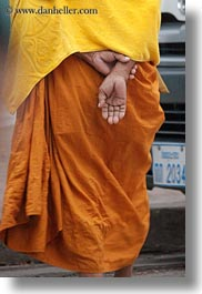 asia, asian, hands, helping, laos, luang prabang, men, monks, people, procession, vertical, photograph