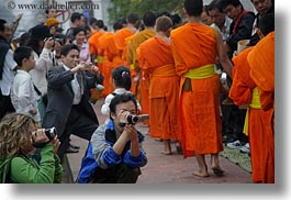 asia, asian, cameras, colors, horizontal, laos, luang prabang, men, monks, oranges, people, photographing, procession, photograph