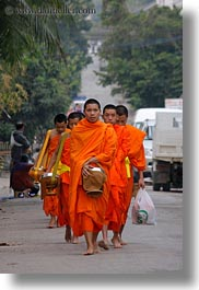 asia, asian, colors, laos, luang prabang, men, monks, oranges, people, procession, vertical, walking, photograph