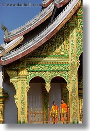 asia, asian, colors, laos, luang prabang, men, monks, oranges, palace, people, temples, two, vertical, photograph