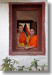 asia, asian, colors, laos, luang prabang, men, monks, oranges, people, two, vertical, windows, photograph