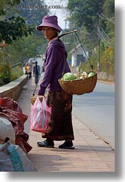 asia, carrying, clothes, don ganh, hats, laos, luang prabang, people, vertical, womens, photograph