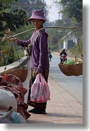 asia, asian, carrying, clothes, don ganh, hats, laos, luang prabang, people, vertical, womens, photograph
