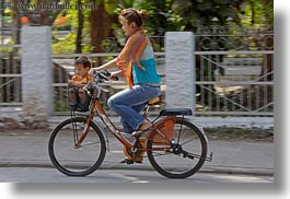 Bikes With Baskets For Women Woman on Bike with Baby in
