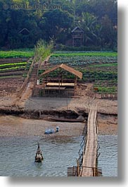 agriculture, asia, bamboo, bridge, buildings, huts, laos, luang prabang, materials, nature, rivers, roofs, scenics, structures, thatched, vertical, water, photograph