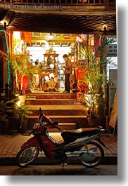 asia, bicycles, bikes, fronts, laos, luang prabang, nite, stores, transportation, vertical, photograph