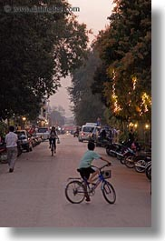 asia, bicycles, bikes, boys, laos, luang prabang, streets, transportation, vertical, photograph