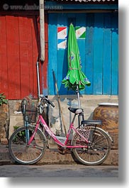 asia, bicycles, bikes, green, laos, luang prabang, pink, transportation, umbrellas, vertical, photograph