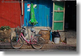 asia, bicycles, bikes, green, horizontal, laos, luang prabang, pink, transportation, umbrellas, photograph