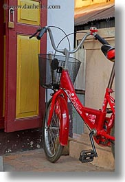 asia, baskets, bicycles, bikes, laos, luang prabang, red, transportation, vertical, photograph
