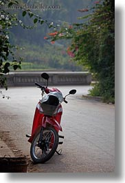 alone, asia, bikes, laos, luang prabang, motorcycles, red, streets, transportation, vertical, photograph