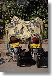 asia, bikes, horses, laos, luang prabang, motorcycles, rugs, transportation, two, under, vertical, photograph