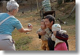 asia, asian, cameras, childrens, emotions, fathers, hmong, horizontal, laos, people, smiles, tourists, viewing, villages, photograph