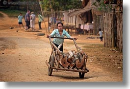asia, carts, hmong, horizontal, laos, logs, pushing, villages, womens, photograph