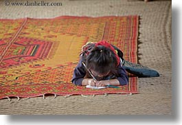 asia, buildings, classroom, girls, hmong, horizontal, laos, paper, pencil, rugs, school, structures, villages, photograph