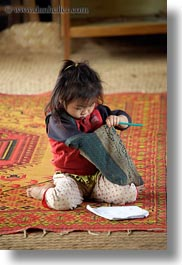 asia, buildings, classroom, girls, hmong, laos, paper, pencil, rugs, school, structures, vertical, villages, photograph